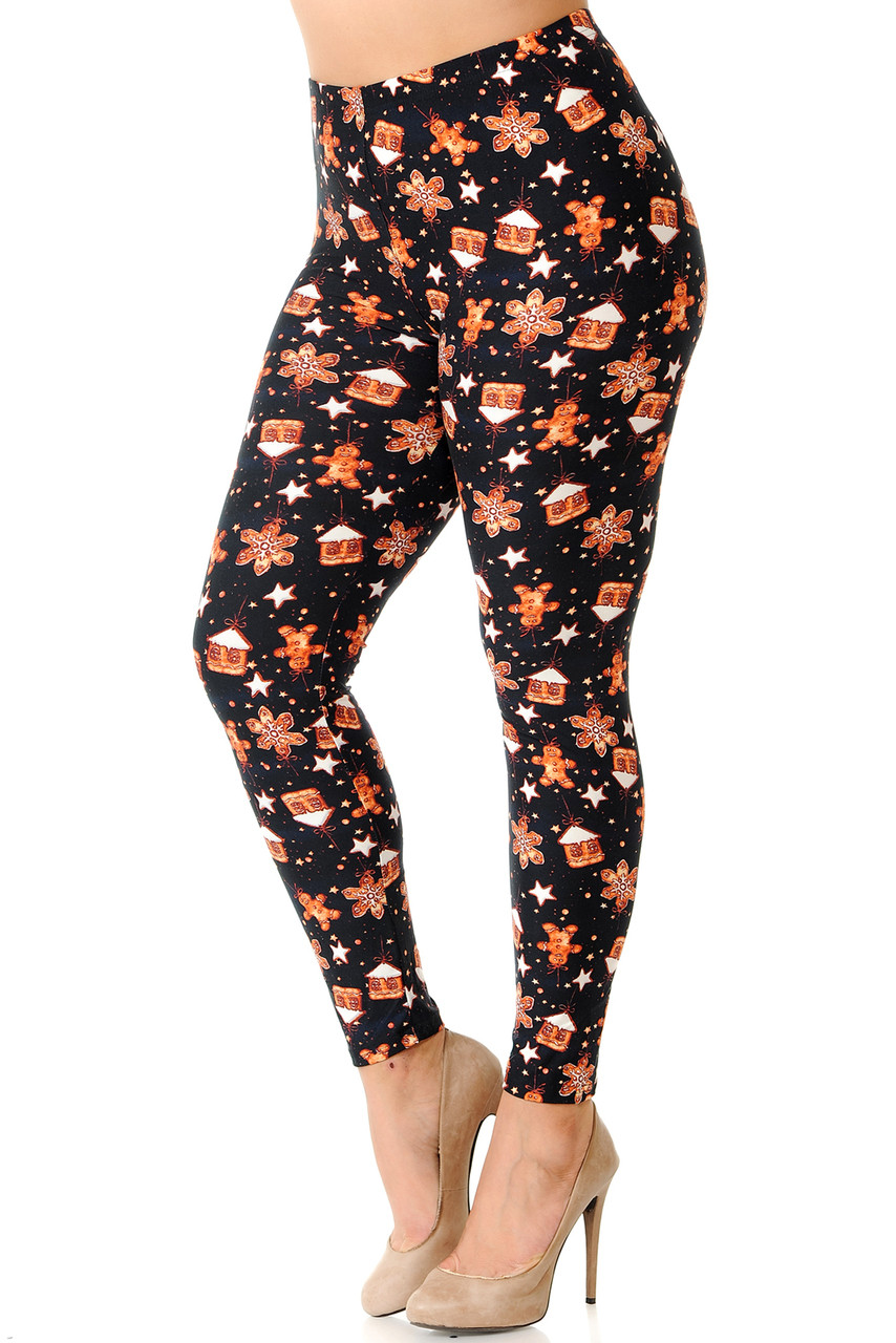 Left side image view of Buttery Soft Gingerbread Christmas Plus Size Leggings featuring cute gingerbread men and frosted cookie houses against a black background.