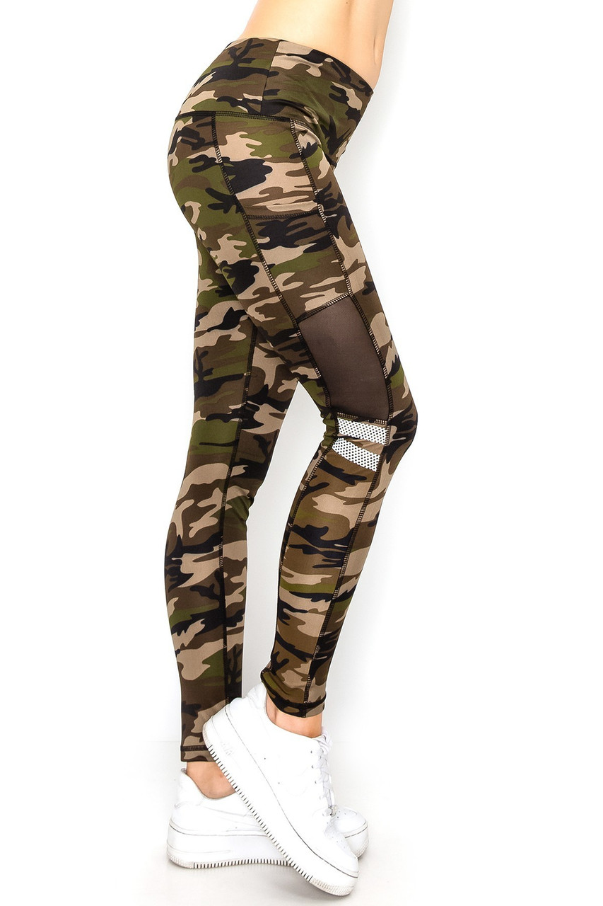 Right side view image of Camouflage Mesh High Waisted Sport Leggings with Side Pocket featuring a classic olive hued army print with black sheer panels, and white perforated mesh panels.
