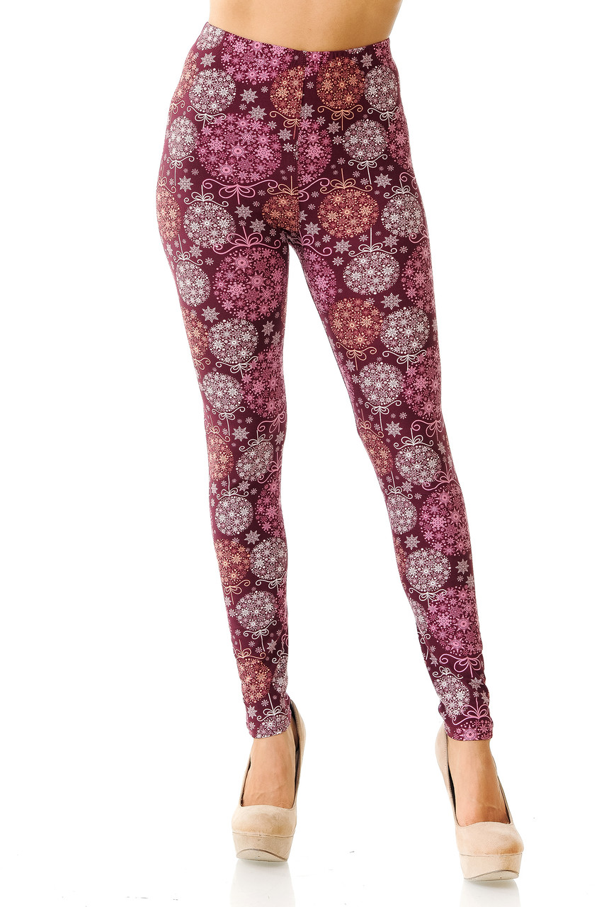 Front view of mid rise Buttery Soft Festive Snowflake Ornaments Leggings featuring an elastic comfort stretch waist.