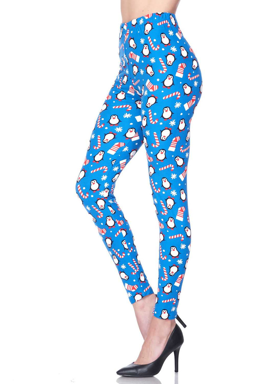 Left side view image of Buttery Soft Icy Blue Christmas Penguins Leggings with a colorful festive design that is perfect for the holiday season.