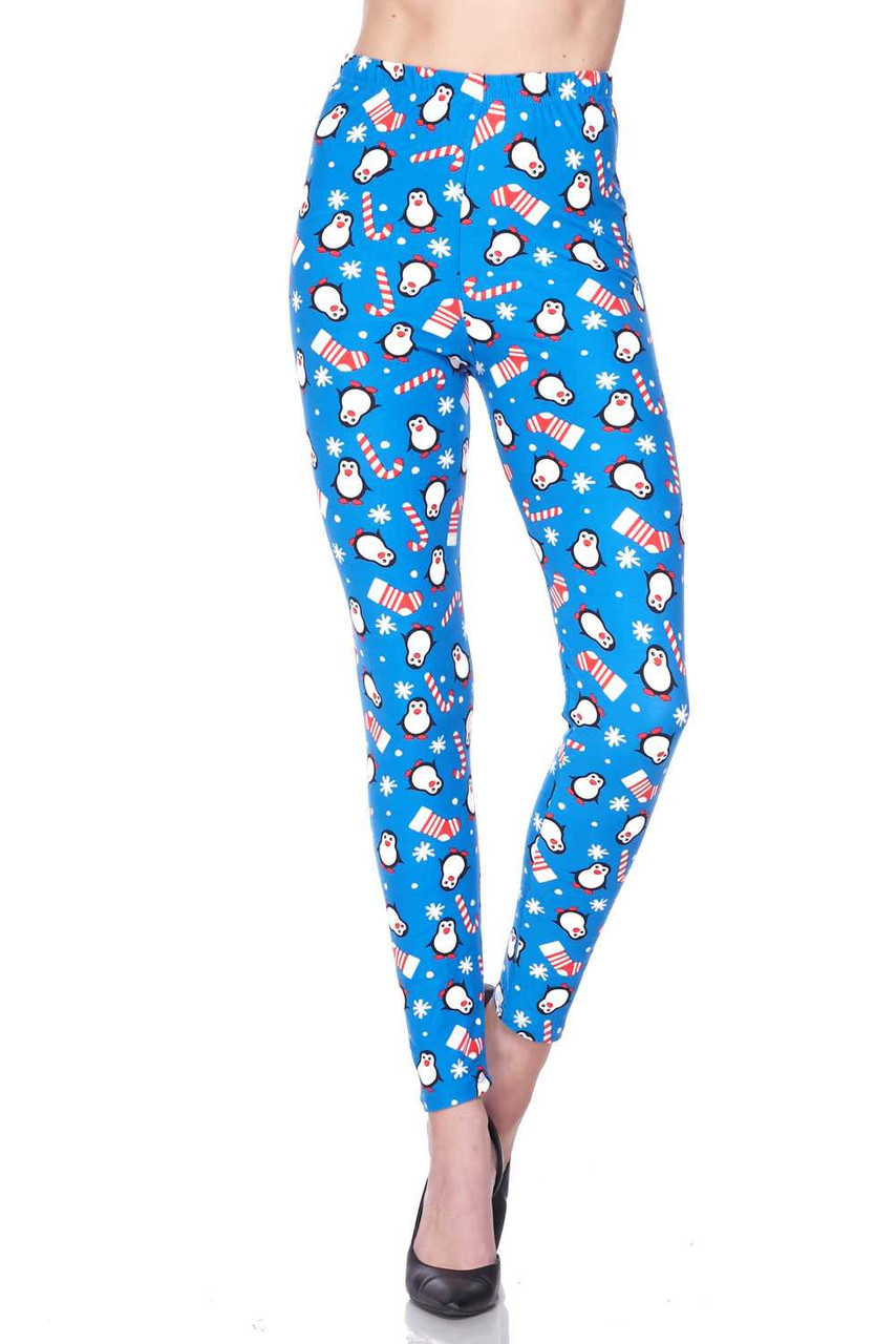 Front view of our mid rise Buttery Soft Icy Blue Christmas Penguins Plus Size Leggings featuring a comfort stretch waist band.