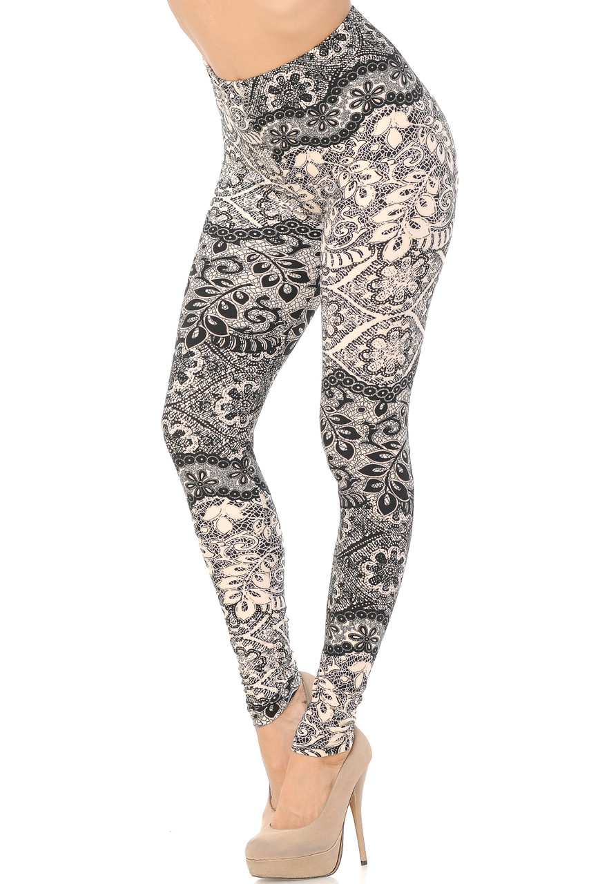 Bent knee Left side view image of Buttery Soft Cream Exquisite Leaf Plus Size Leggings featuring a gorgeous decorative neutral design consisting of lace inspired black and white floral prints that goes with dressy or casual tops of any color for all seasons.