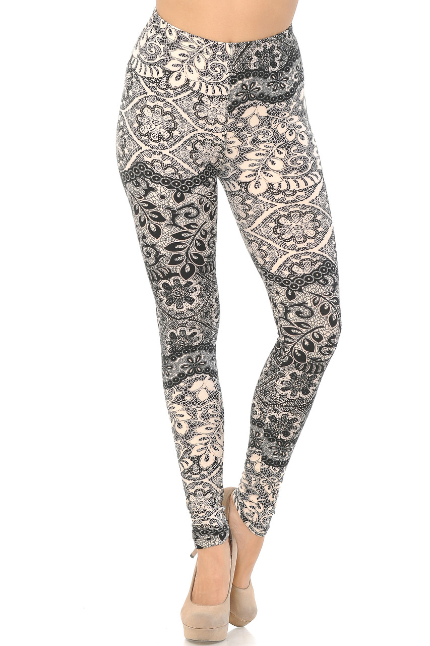 Front view image of our mid rise Buttery Soft Cream Exquisite Leaf Extra Plus Size Leggings featuring a comfort stretch elastic waistband.