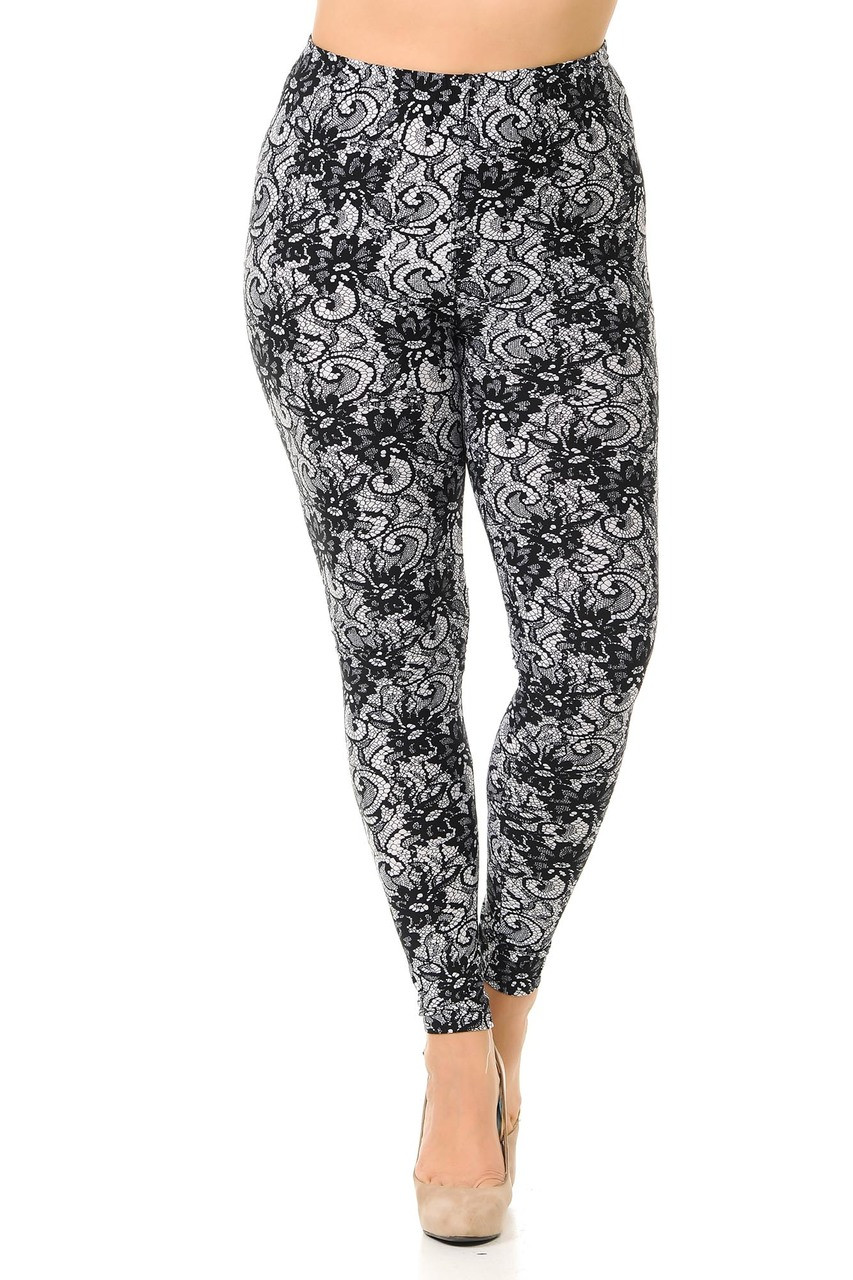Front view image of our Buttery Soft Sassy Lace Print Plus Size Leggings featuring a full length skinny leg cut.