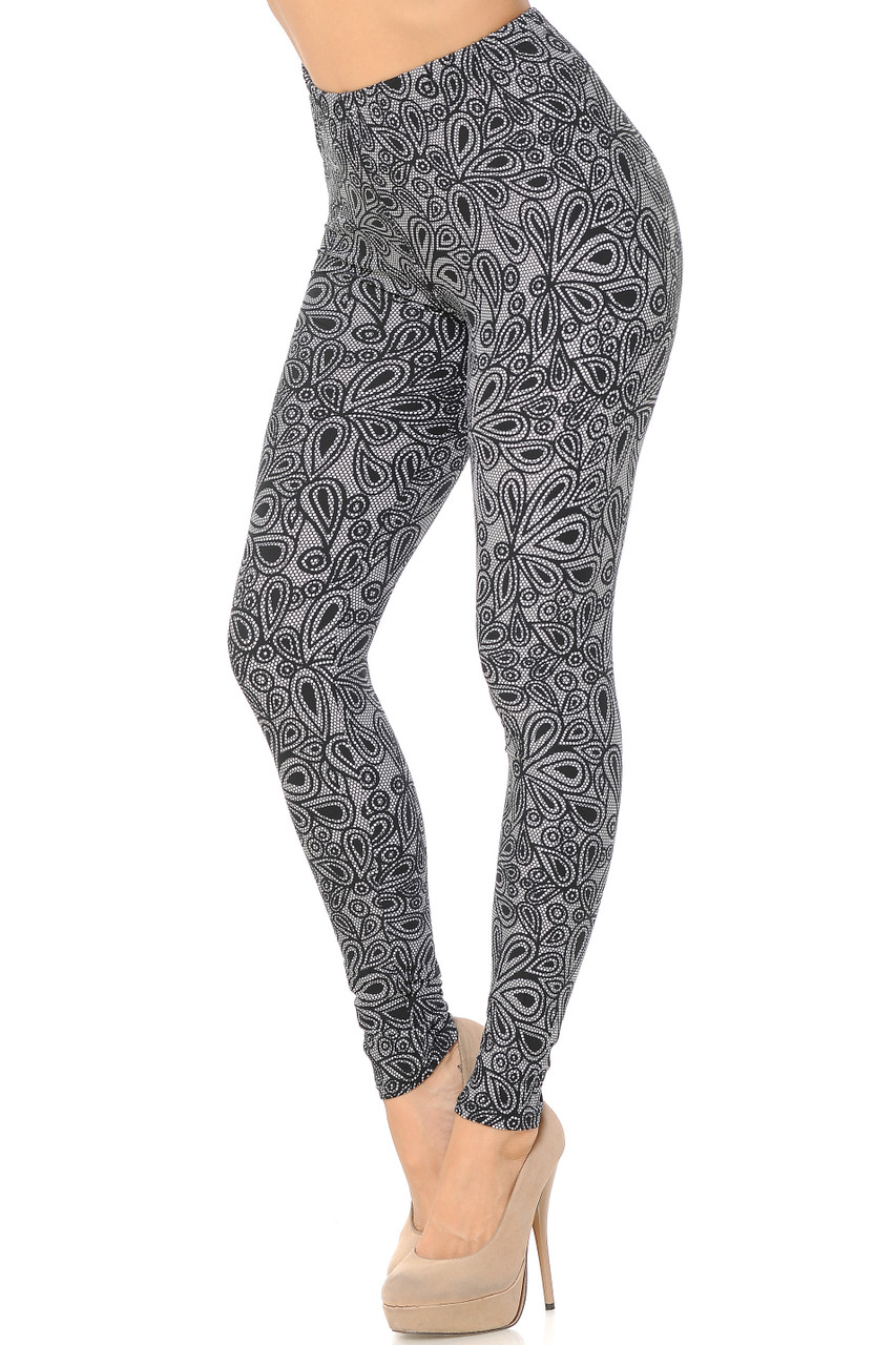 Left side image view of our charcoal toned Buttery Soft Netted Petal Leggings featuring a neutral color scheme and a simple petal print that pairs with a top of any color and style.