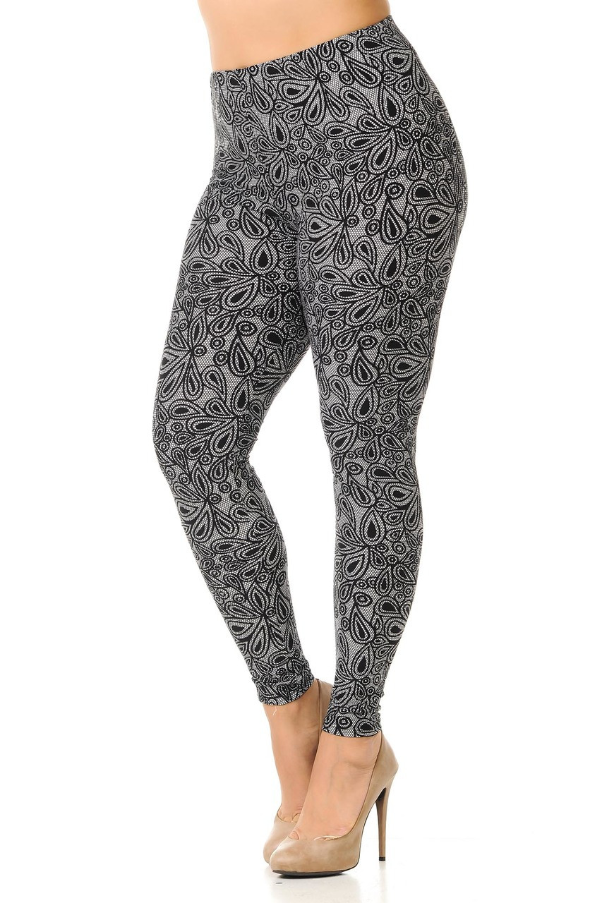 Left side image view of our charcoal toned Buttery Soft Netted Petal Extra Plus Size Leggings featuring a neutral color scheme and a simple petal print that pairs with a top of any color and style.