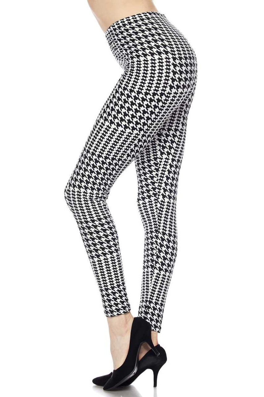Left side view image of Buttery Soft In Motion Houndstooth Plus Size Leggings featuring a mixed large and small scale dogtooth print in a neutral black an white color scheme.