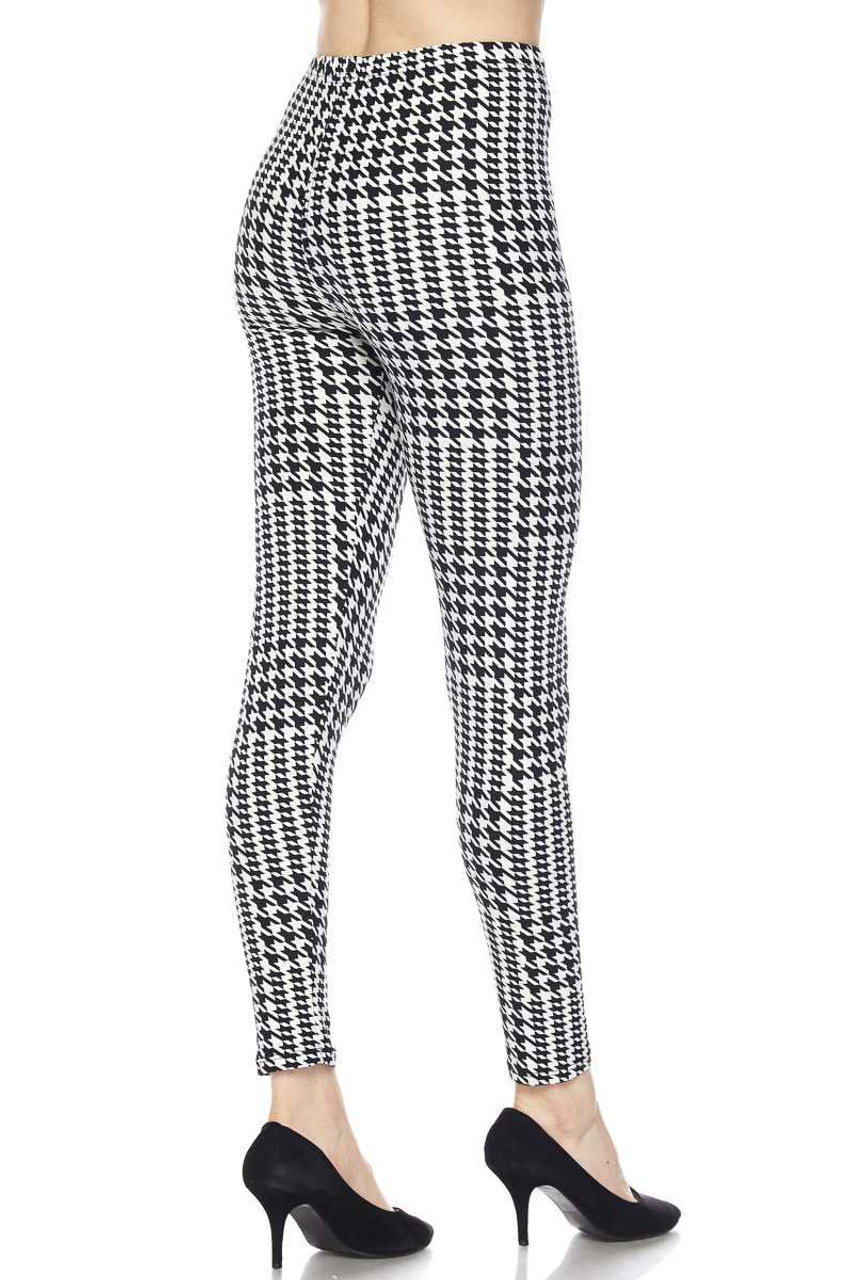 Right side/partial back view image of Buttery Soft In Motion Houndstooth Plus Size Leggings showcasing the all over 360 degree classic print that is compatible with any season.