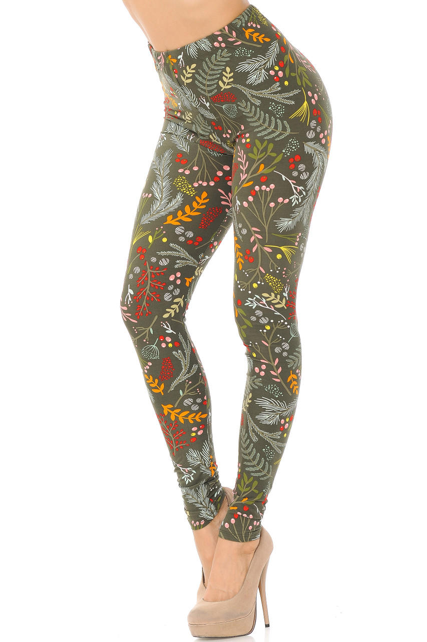 Left view image of Buttery Soft Olive Garden Leggings with a deep brownish green background decorated with a yellow, red, and lighter green floral design.
