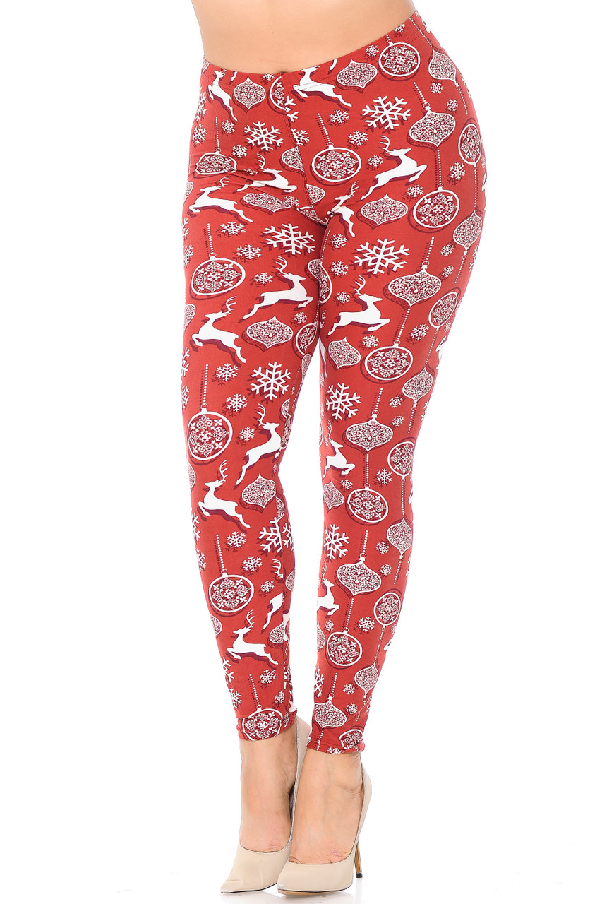 Flat image view of Buttery Soft Jumping Christmas Reindeer Plus Size Leggings  featuring a red on white reindeer and ornament print with a drop shadow effect that make them pop.