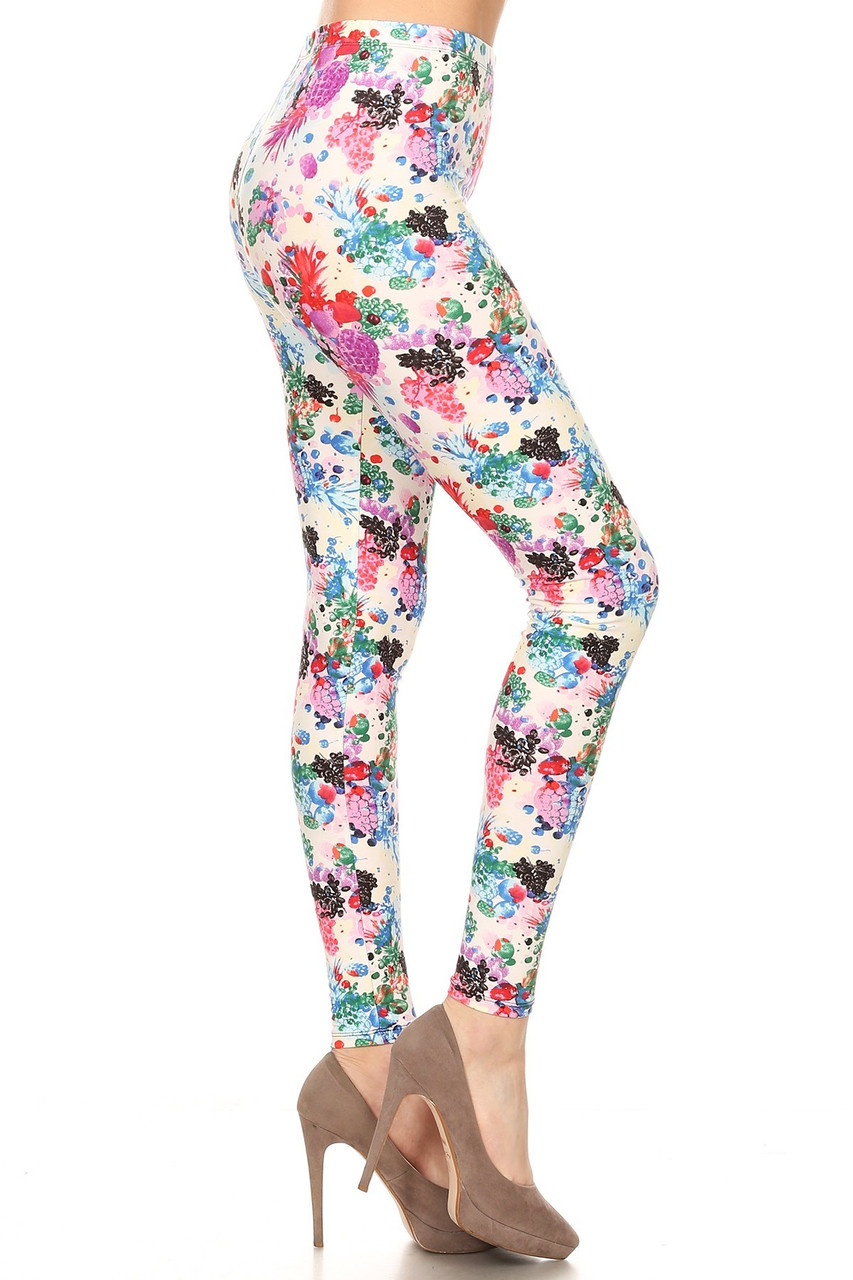 Right side view image of Buttery Soft Ivory Fruit Bunch Plus Size Leggings featuring a colorful print of abstract style pineapples and grapes, atop a white background.