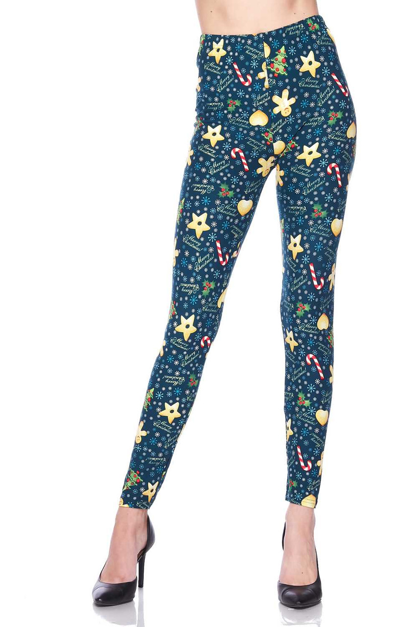 """Front view image view of Buttery Soft A Very Merry Christmas Leggings featuring a green background decorated with snowflakes, holiday cookies, and the words """"Merry Christmas."""""""