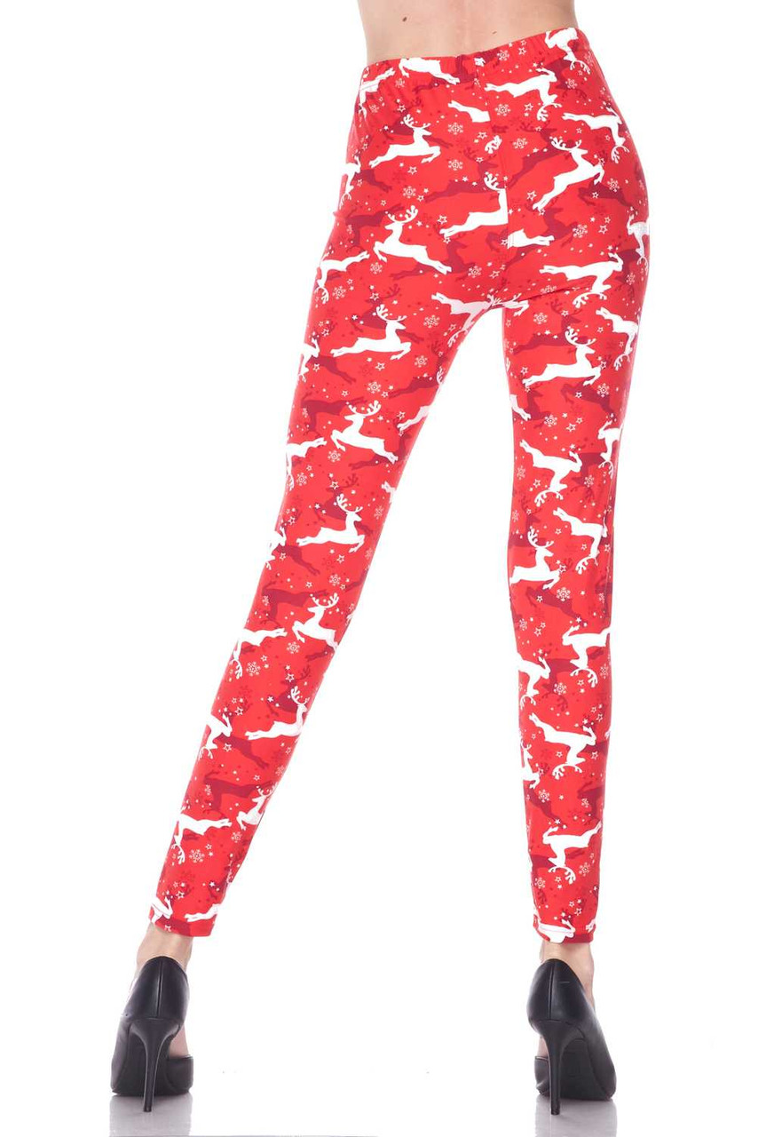 Back view of our super flattering figure hugging Buttery Soft Ruby Red Leaping Reindeer Christmas Leggings