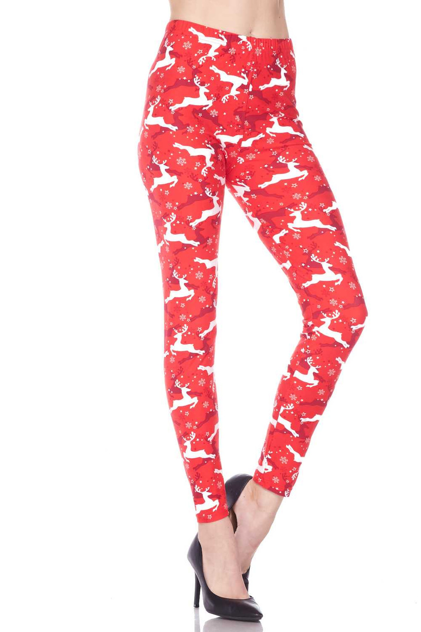 Left side leg image of  Buttery Soft Ruby Red Leaping Reindeer Christmas Leggings