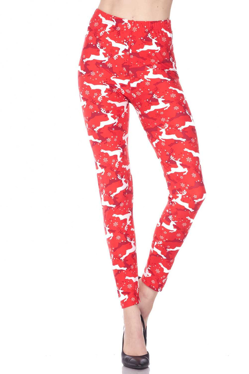 Front view image of Buttery Soft Ruby Red Leaping Reindeer Christmas Leggings featuring an elastic stretch waistband that comes to about mid rise.