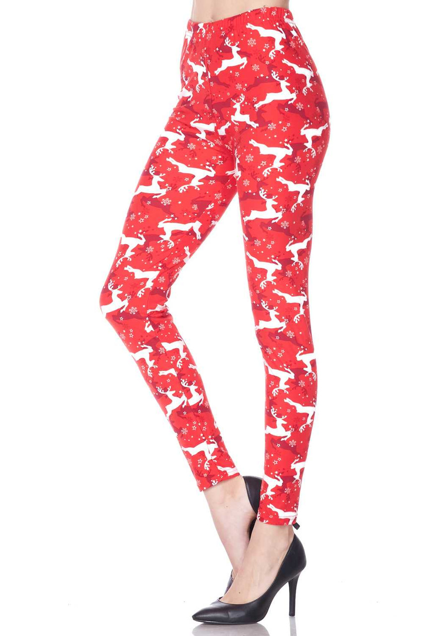 Left side leg image of  Buttery Soft Ruby Red Leaping Reindeer Christmas Plus Size Leggings