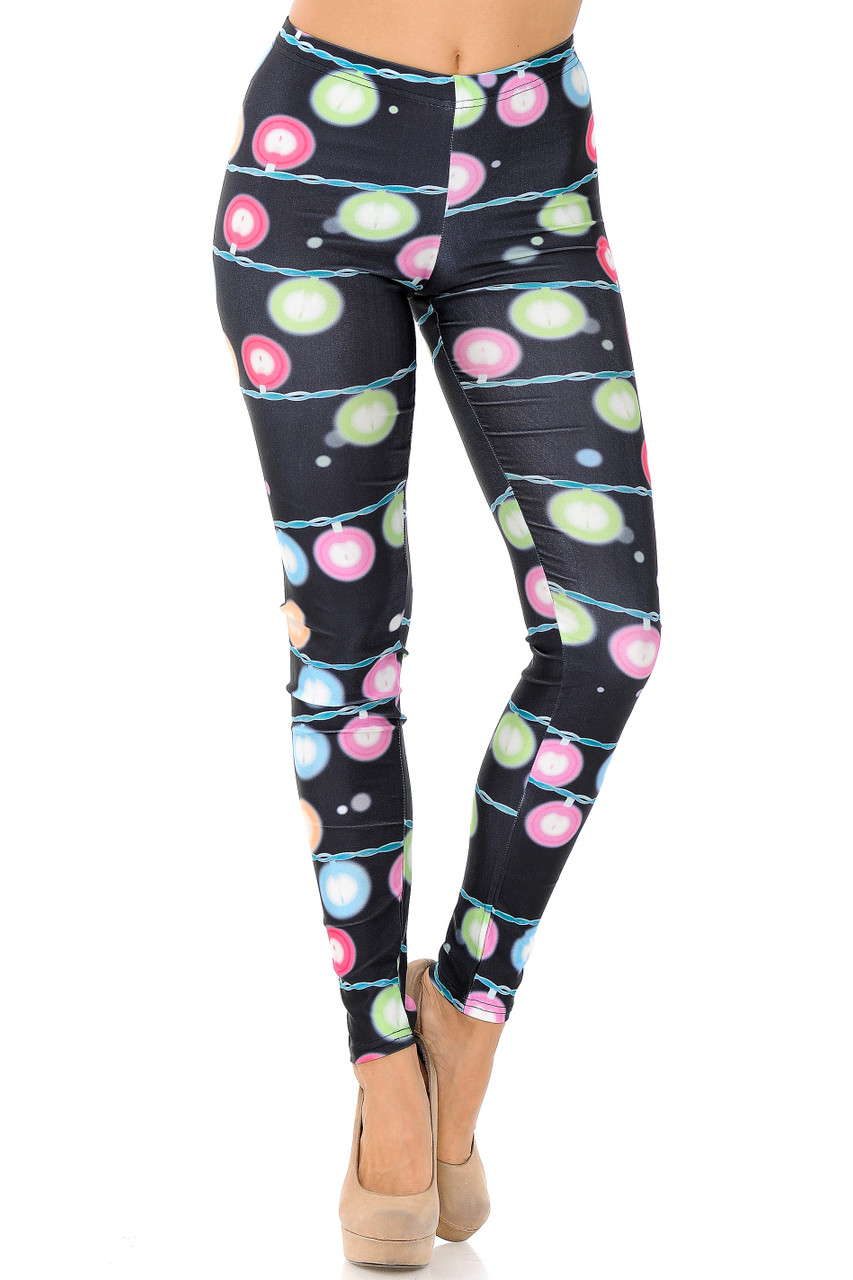 Front view of Festive Holiday Lights Leggings with a comfort elastic mid rise waist.