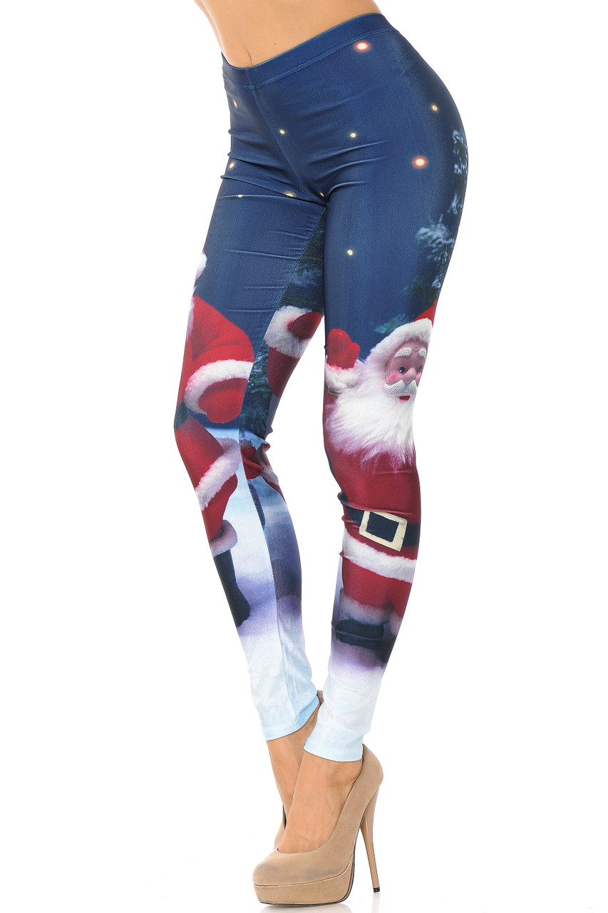 Left view image ofMain Front Santa Claus Leggings featuring a big bold image of santa against a dark blue night sky.