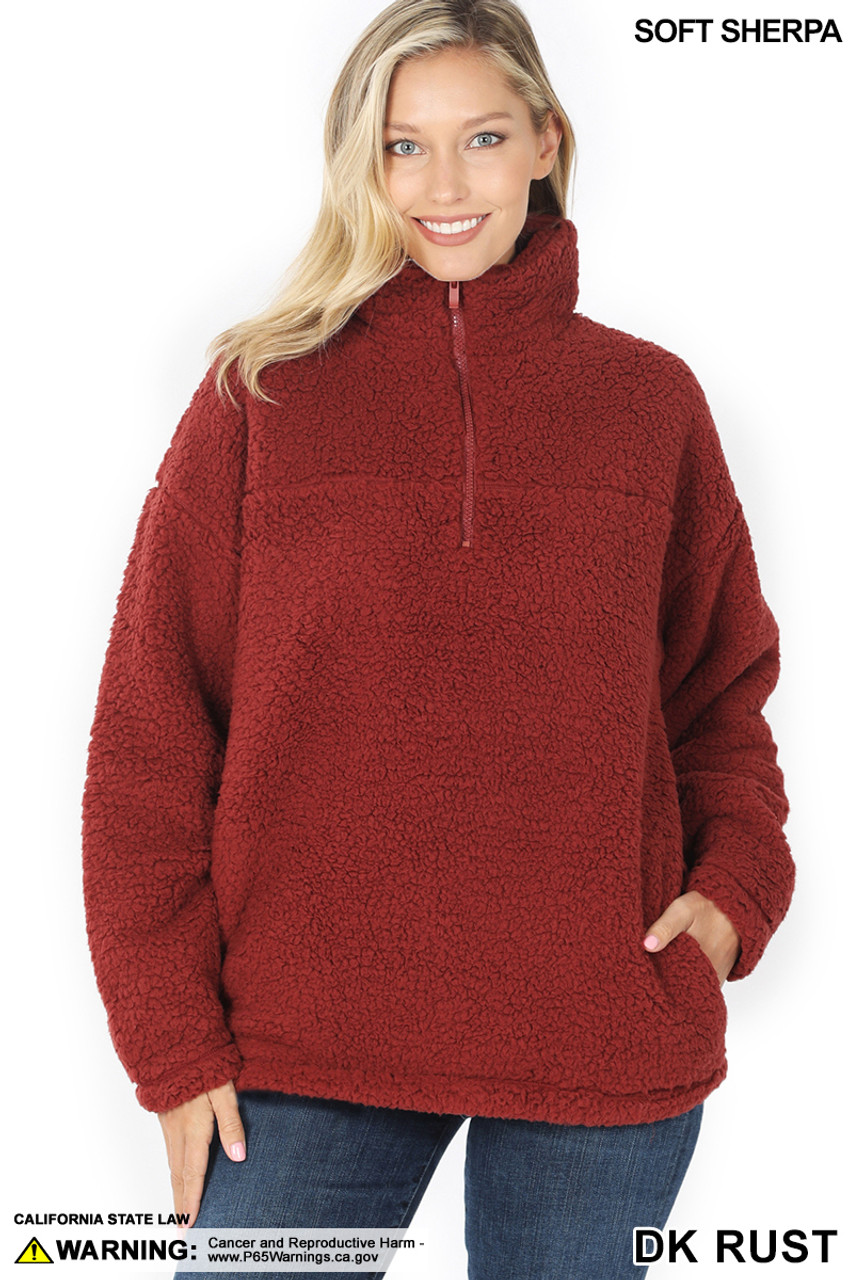 Front image of Dark Rust Sherpa Half Zip Pullover with Side Pockets