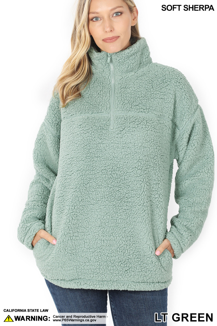 Front image of Light Green Sherpa Half Zip Pullover with Side Pockets