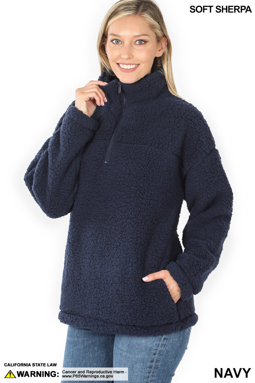 Slightly turned image of Navy Sherpa Half Zip Pullover with Side Pockets