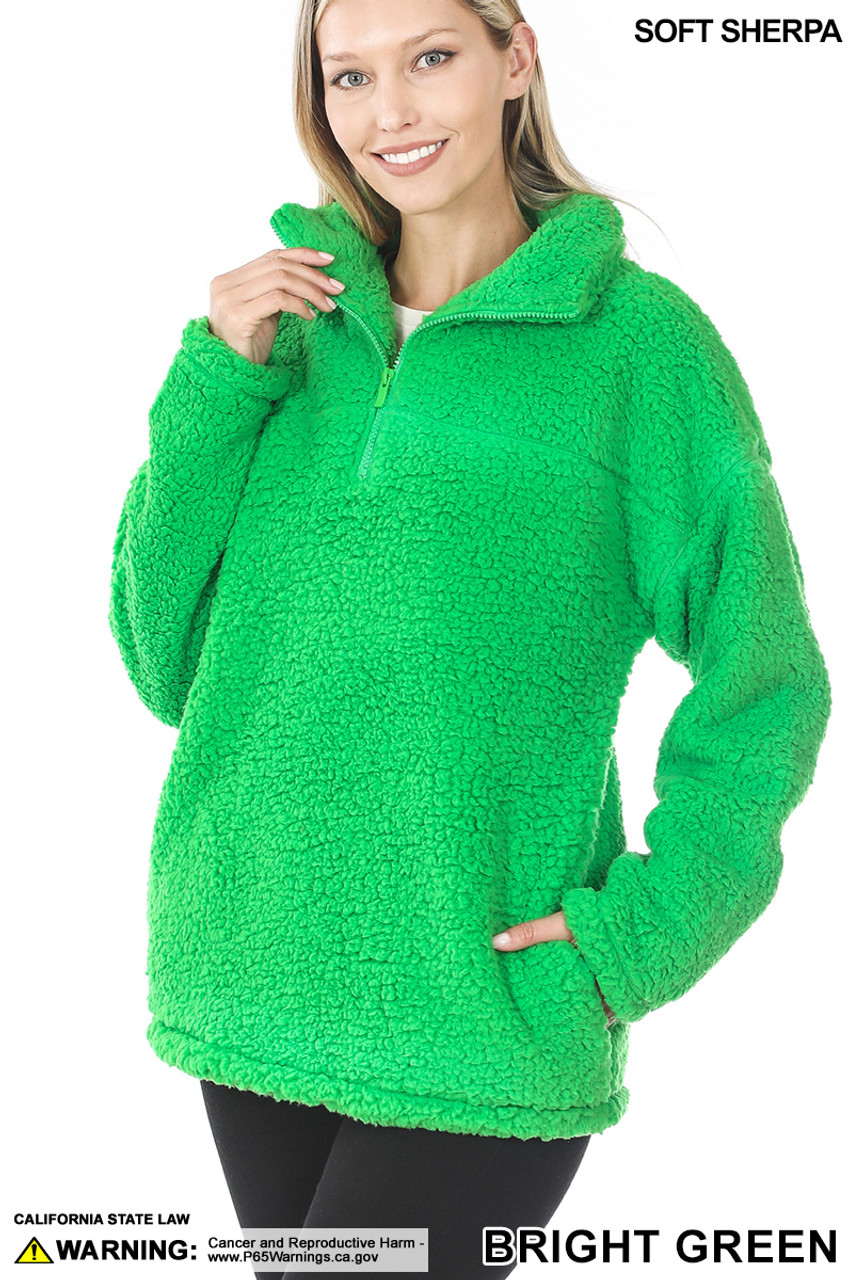 Slightly turned image of Bright Green Sherpa Half Zip Pullover with Side Pockets