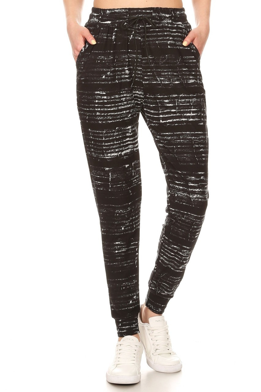 Front view image of Buttery Soft Ebony Moondust Plus Size Joggers featuring an elastic tie string waist and pockets.