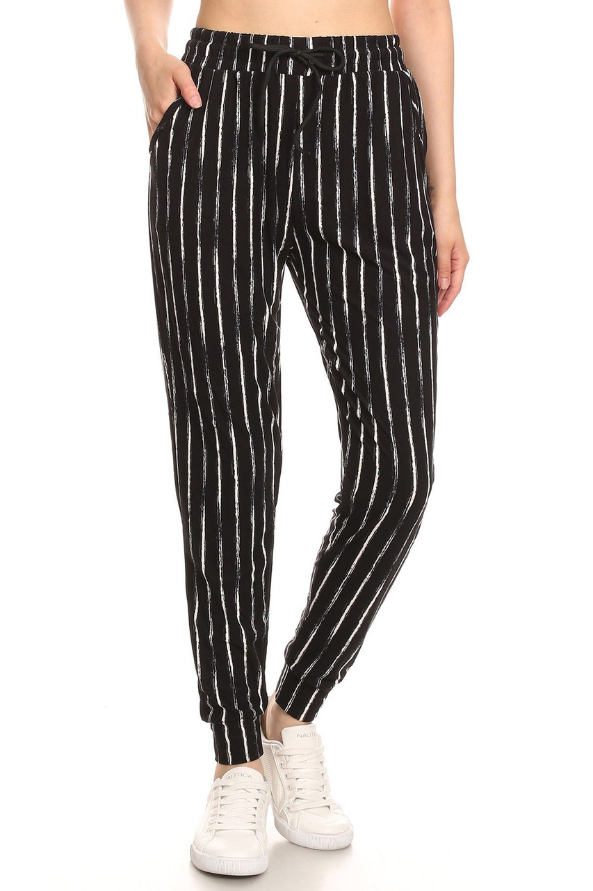 Front view of Buttery Soft Rustic Pinstripe Joggers with a neutral black and white faded striped print that pairs with a top of any color for any season.