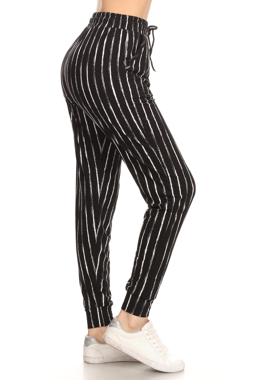 Right side view leg of Buttery Soft Rustic Pinstripe Joggers with an elastic tie string waist and a pockets.