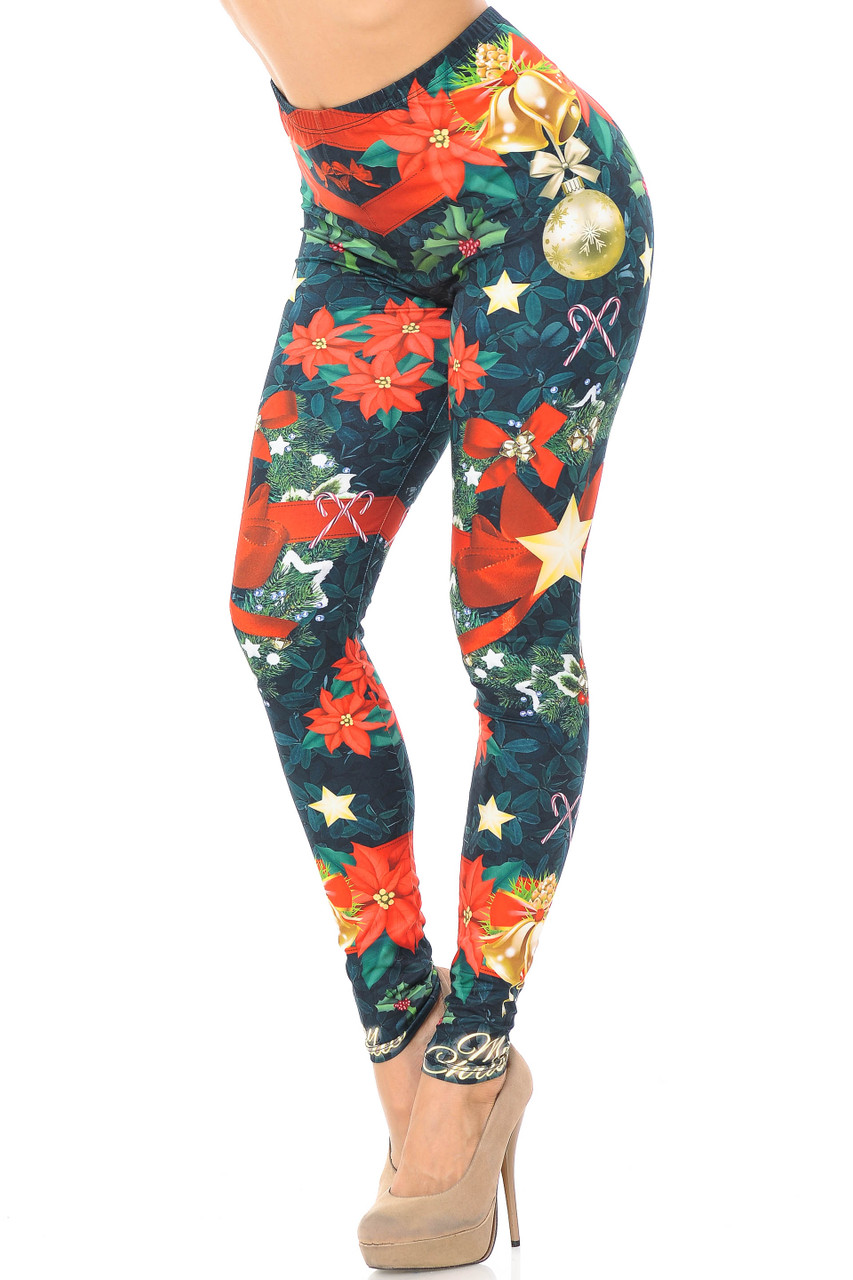 Partial front/left side view image of Creamy Soft I Love Christmas Extra Plus Size Leggings - 3X-5X - USA Fashion™ featuring an all over colorful print of poinsettias, red bows, stars, and mistletoe atop a green leaf background.