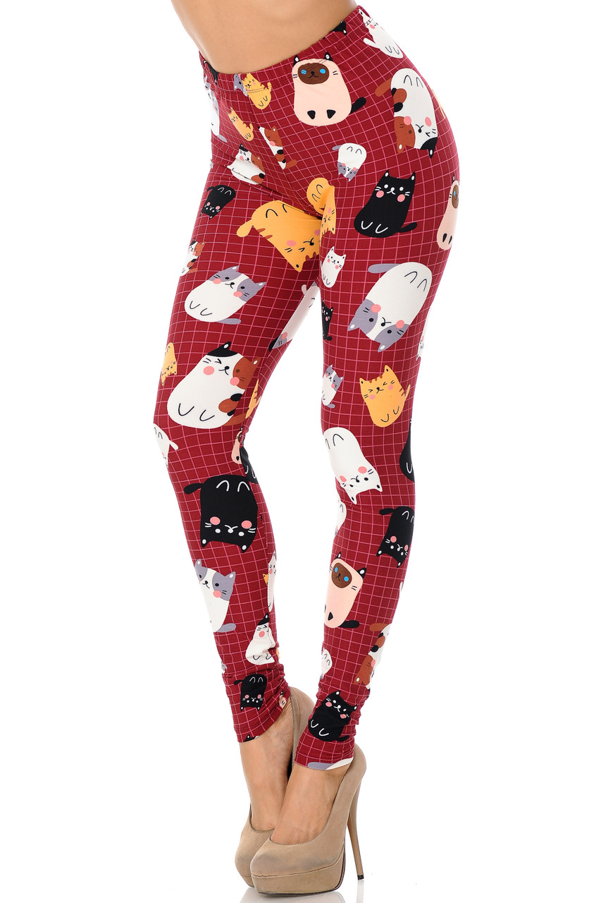 Front view of Buttery Soft Cartoon Kitty Cats Plus Size Leggings with a red background featuring a white grid pattern decorated with cute kitties.