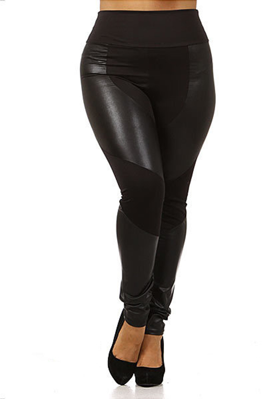 Front view of our edgy all black Chatelaine Faux Leather High Waisted Plus Size Leggings featuring a mix of fabric and faux leather panels.