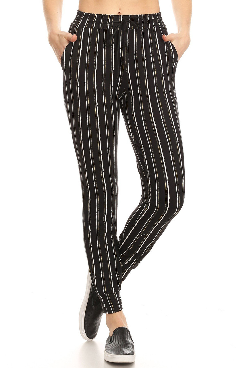 Front view of our Buttery Soft Vertical Artistic Stripe Joggers with a neutral black and white color scheme that pairs with a top of any color.