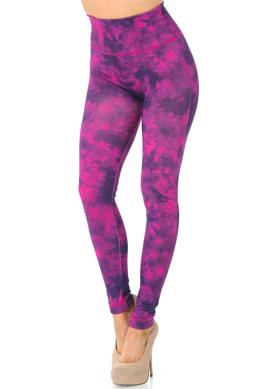 Partial front/angled left view image of fuchsia Tie Dye High Waisted Leggings with a purple dyed accent print.