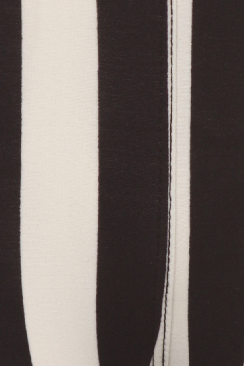 Close up swatch image of Buttery Soft Vertical Black and White Striped Kids Leggings