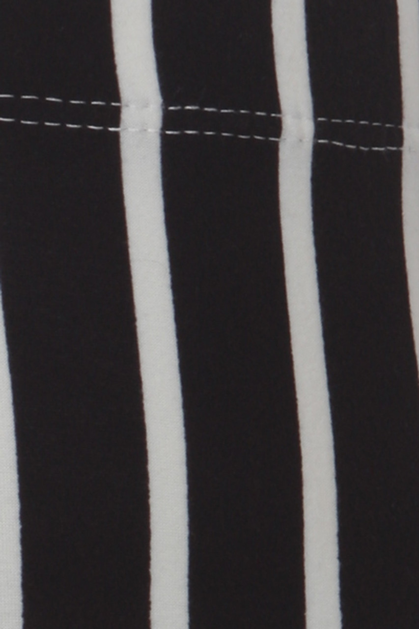Close up swatch of Buttery Soft Black Pinstripe Kids Leggings