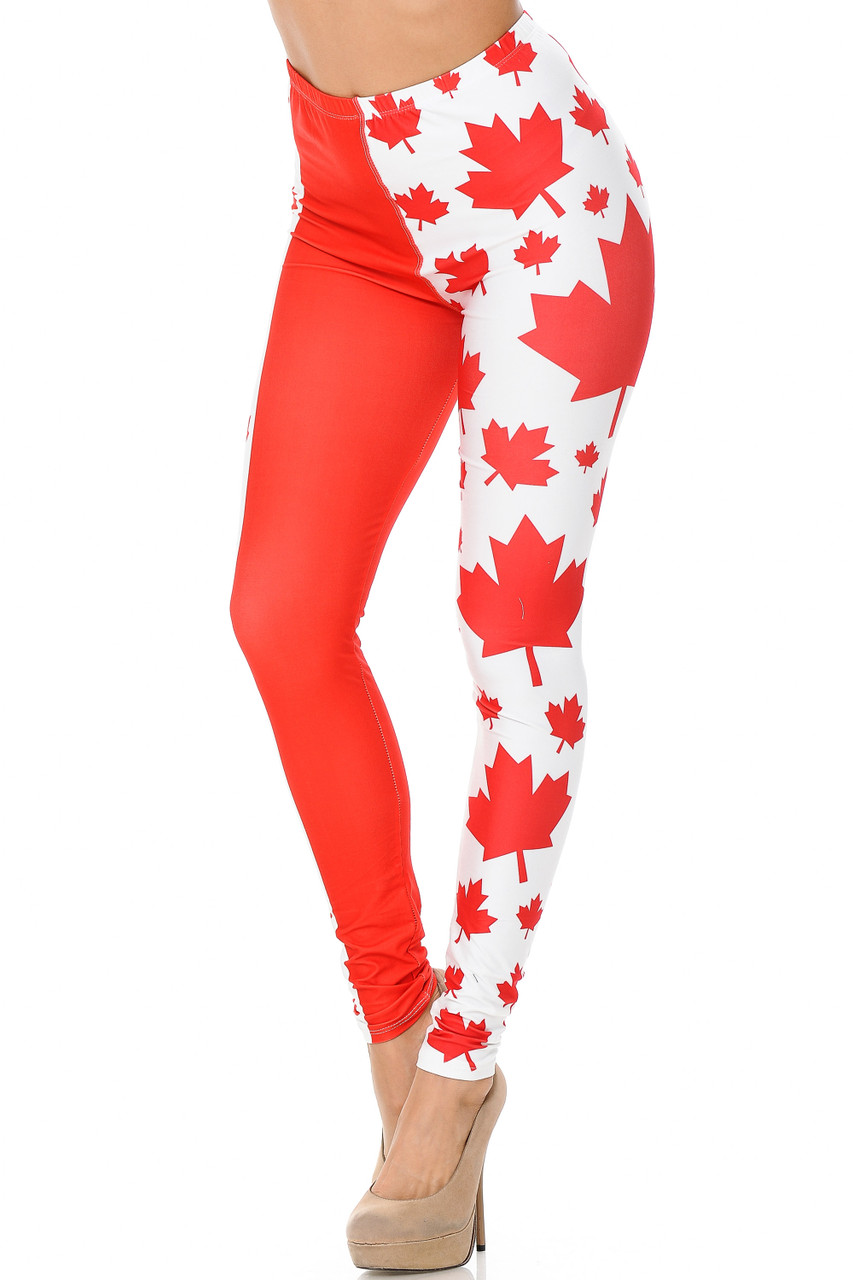 Our Creamy Soft Canadian Flag Plus Size Leggings feature a cool vertical design with solid red panels and red maple leaf print on a white background panels.