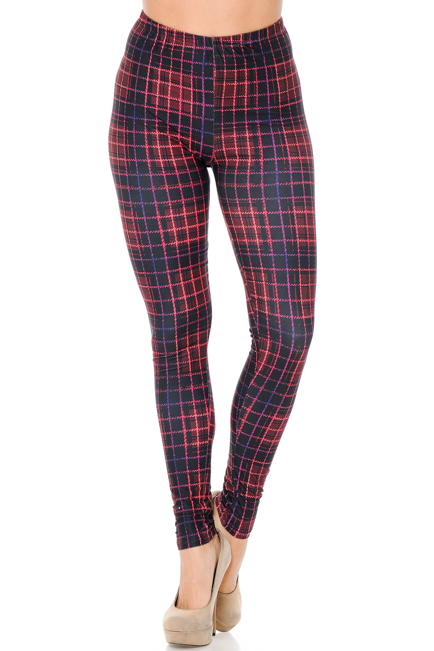 With an elastic banded comfort stretch waist our Creamy Soft 3D Vivid Tartan Leggings come up to about mid rise.
