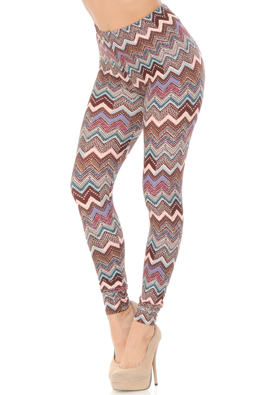 These Buttery Soft Earthen Chevron Plus Size Leggings feature a mostly brown color scheme with hints of pink, aqua, and lilac.