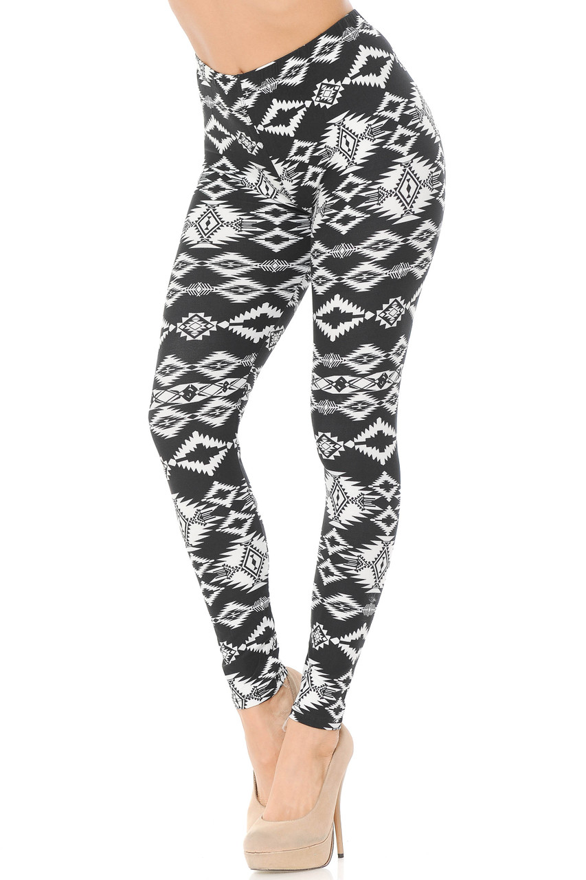 Partial front view of our Buttery Soft Midnight Solstice Tribal Plus Size Leggings feature a black and white diamond style aztec inspired design.