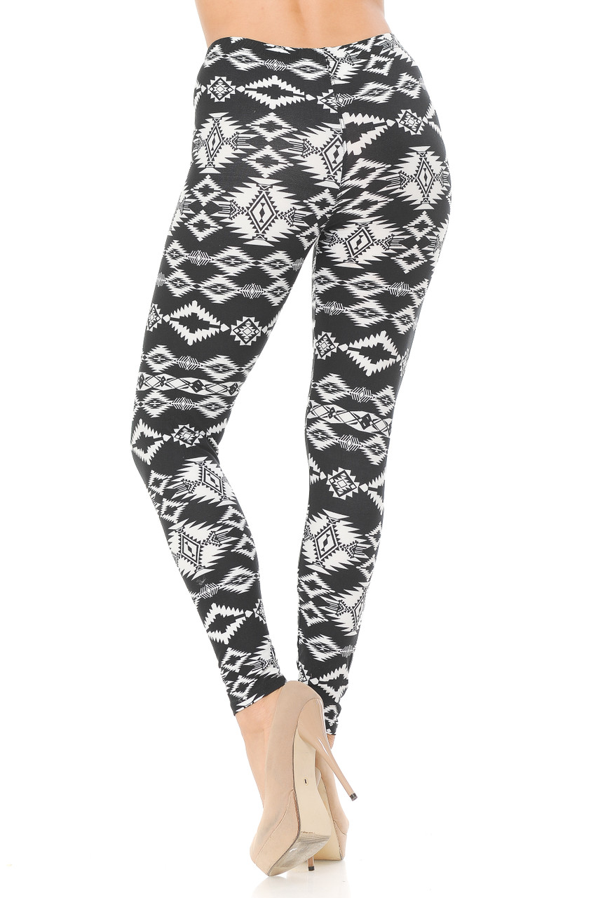 These Buttery Soft Midnight Solstice Tribal Plus Size Leggings feature an elastic comfort stretch waistband that comes up to about mid rise.