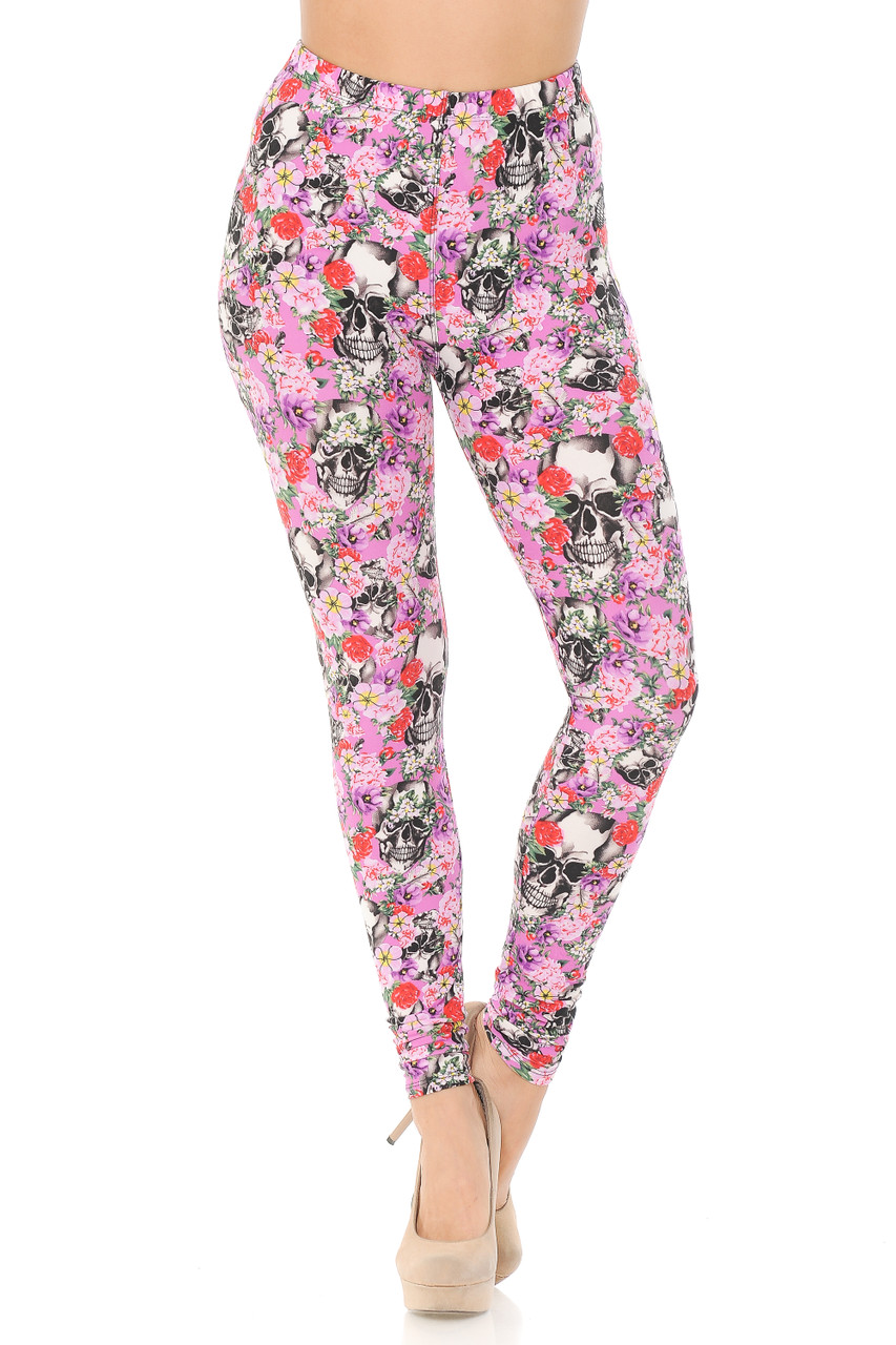 Our Buttery Soft Pink Blossom Skulls Leggings feature a comfort elastic stretch waist that comes up to about mid rise.
