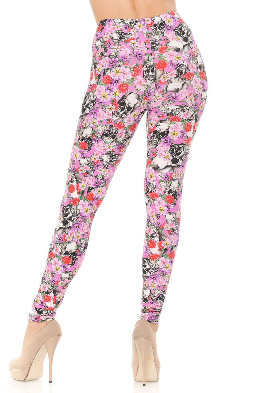 Back view of our flattering body hugging Buttery Soft Pink Blossom Skulls Extra Plus Size Leggings.