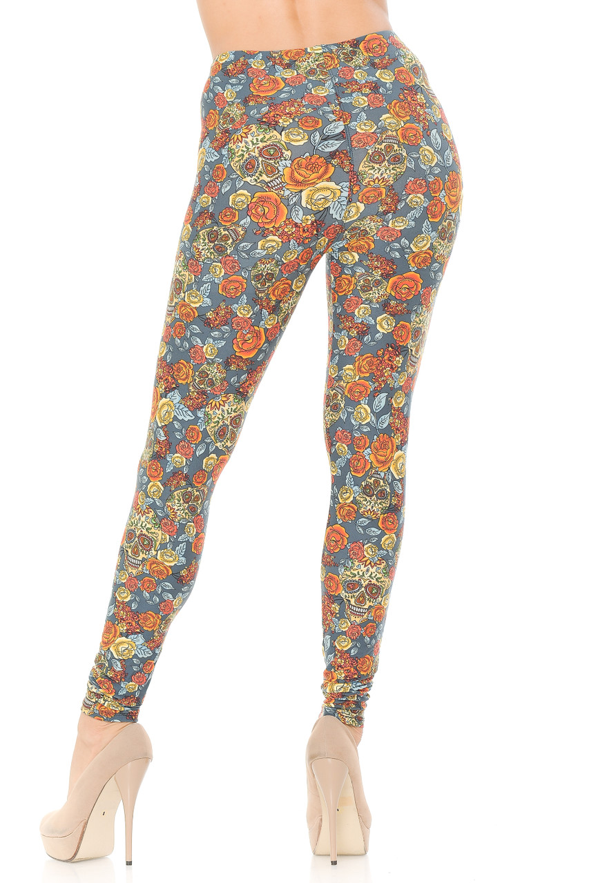 Rear view of our flattering fitted Buttery Soft Charcoal Rose and Skulls Leggings