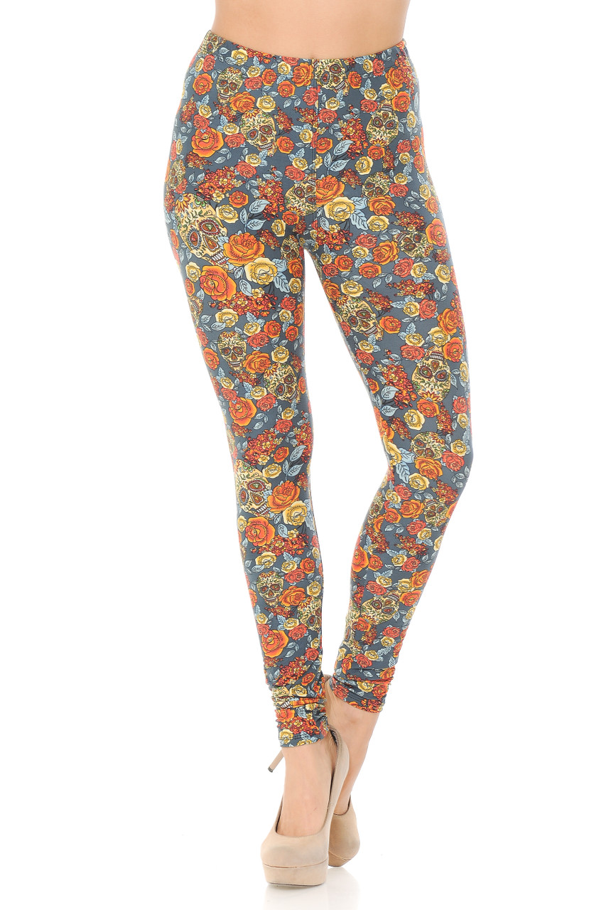 These Buttery Soft Charcoal Rose and Skulls Plus Size Leggings feature an elastic comfort stretch waistband that comes up to about mid rise.