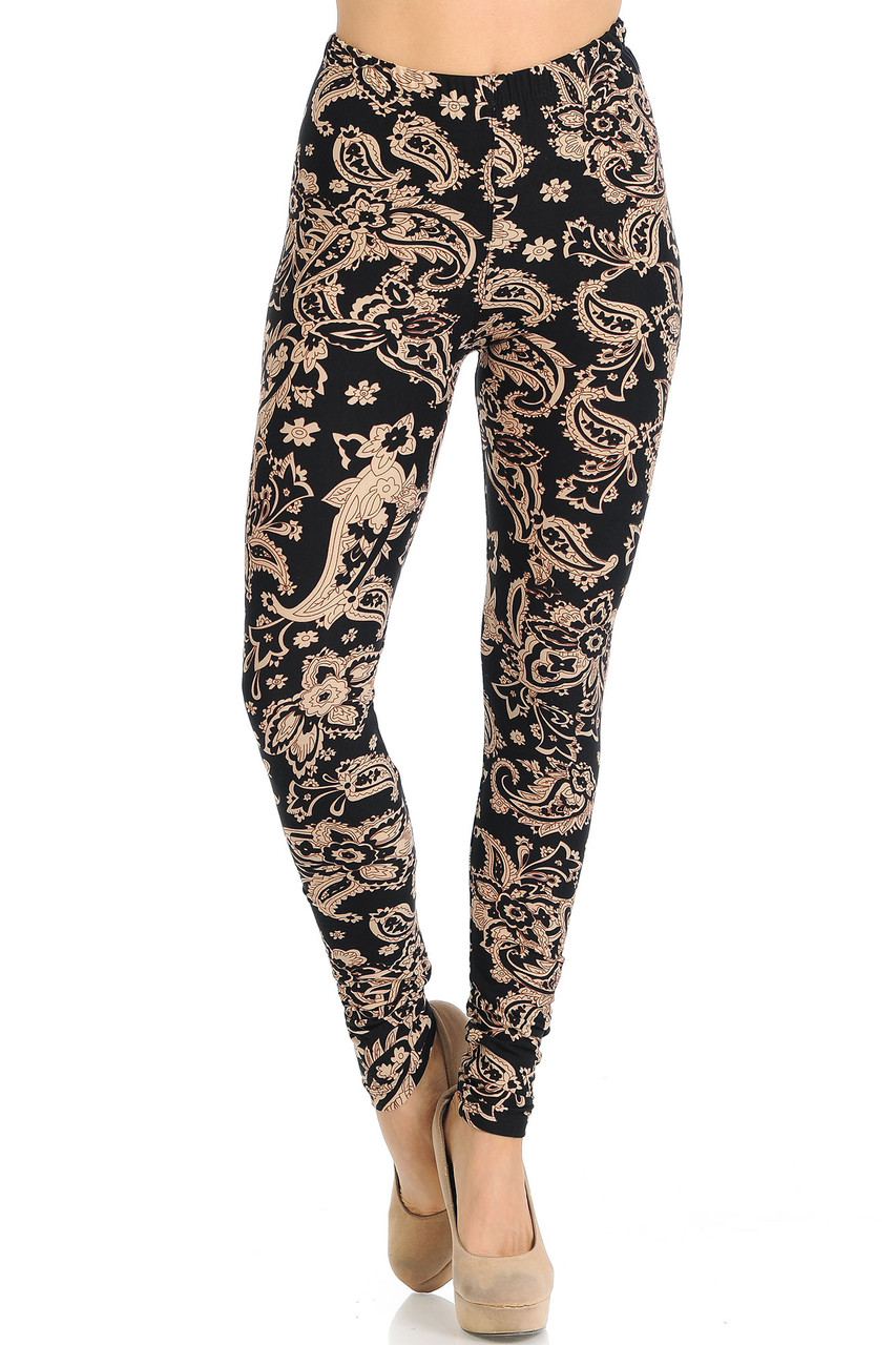 Our Buttery Soft Sand Pepper Paisley Leggings have an elastic comfort stretch waistband that comes up to about mid rise.
