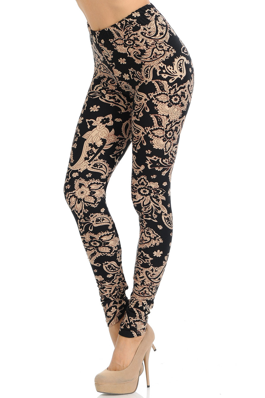 Our Buttery Soft Sand Pepper Paisley Plus Size Leggings feature a black fabric base with an all over light sand toned decorative print with floral accents.