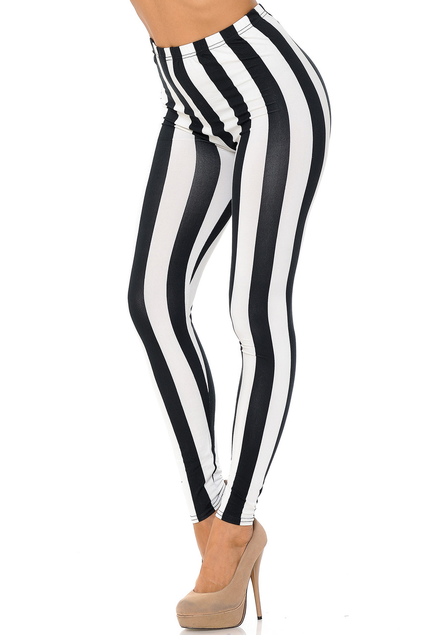 Our Buttery Soft Black and White Wide Stripe Leggings feature a flattering vertical striped design.