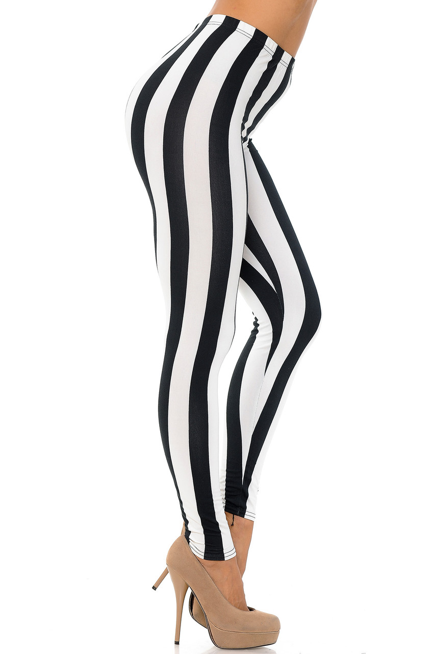 Right side view of Buttery Soft Black and White Wide Stripe Leggings.