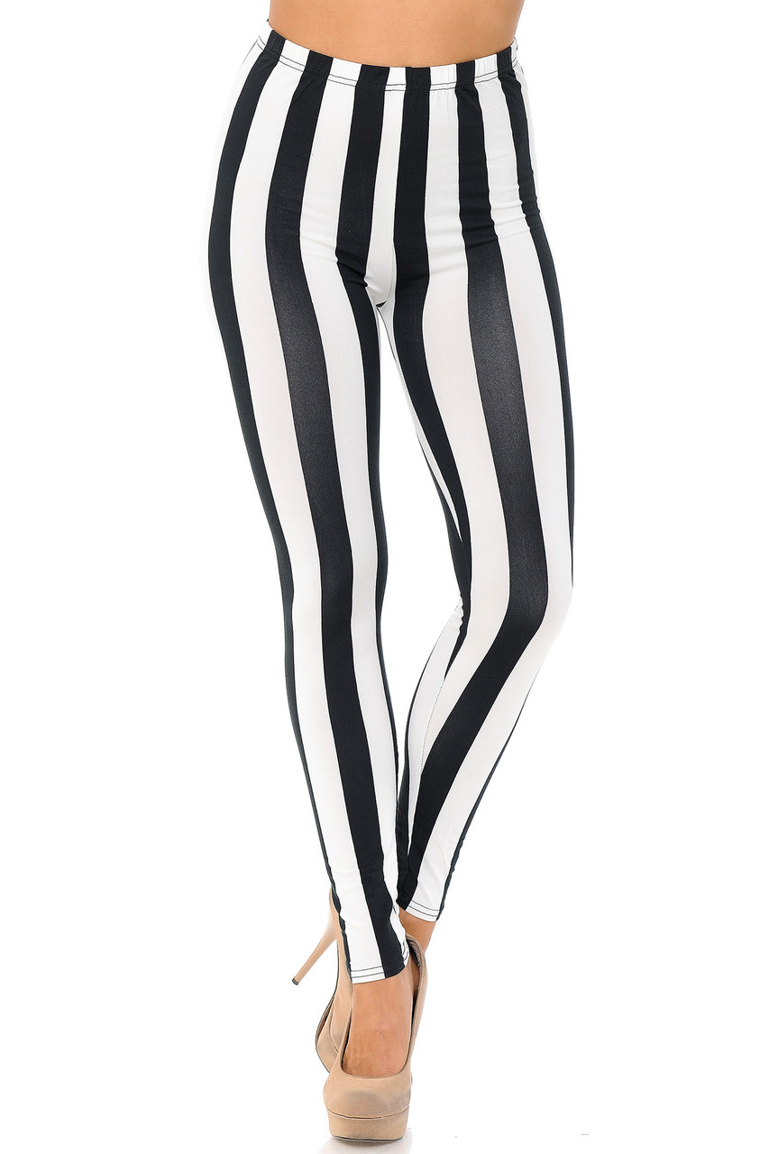 Our Buttery Soft Black and White Wide Stripe Leggings feature an elastic comfort stretch waist band that comes up to about mid rise.